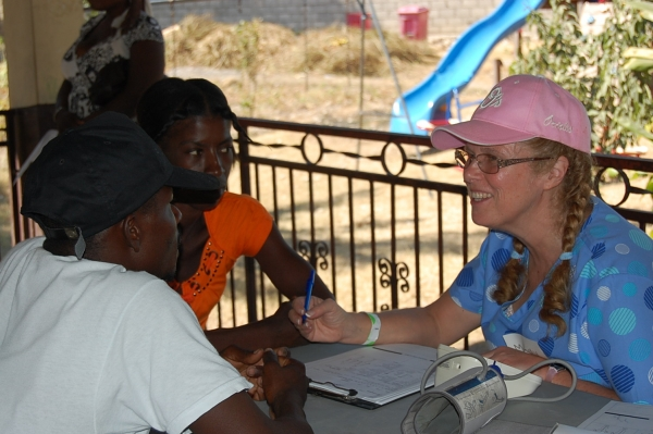 Mandy Gibb (Burtonsville, MD) is not a nurse but plays one in Haiti, while she got vitals on incoming patients as a triage nurse.